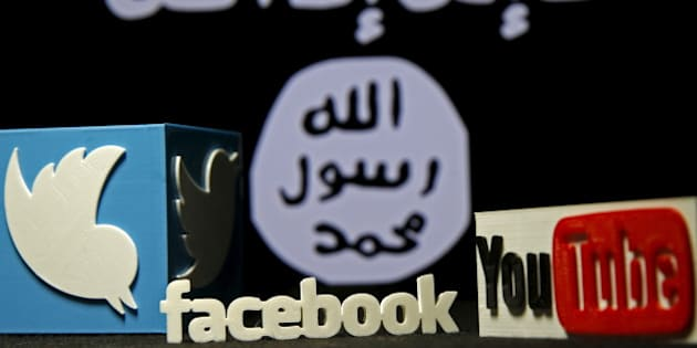 A 3D plastic representation of the Twitter and Youtube logo is seen in front of a displayed ISIS flag in this photo illustration in Zenica, Bosnia and Herzegovina, February 3, 2016. Iraq is trying to persuade satellite firms to halt Internet services in areas under Islamic State's rule, seeking to deal a major blow to the group's potent propaganda machine which relies heavily on social media to inspire its followers to wage jihad. Picture taken February 3, 2016. To match Insight MIDEAST-CRISIS/IRAQ-INTERNET REUTERS/Dado Ruvic      TPX IMAGES OF THE DAY
