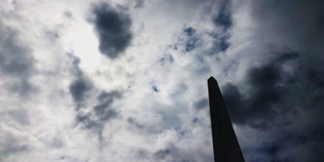 a science fiction type obelisk against a cloud filled sky