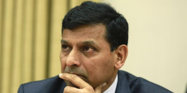 Reserve Bank of India (RBI) Governor Raghuram Rajan listens to a question from a journalist during a news conference at the RBI headquarters in Mumbai, India, Wednesday, Dec. 18, 2013. India's central bank surprised many Wednesday by keeping its key interest rate unchanged despite the worrying rise in inflation. (AP Photo/Rafiq Maqbool)