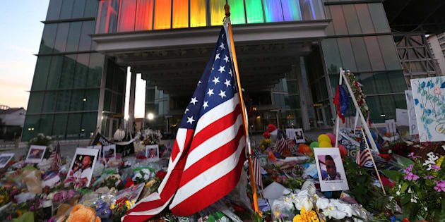 A makeshift memorial to victims of the Pulse nightclub shooting continues to grow in front of the Dr. Phillips Center for the Performing Arts in downtown Orlando, Fla., on Saturday, June 18, 2016. (Stephen M. Dowell/Orlando Sentinel/TNS via Getty Images)