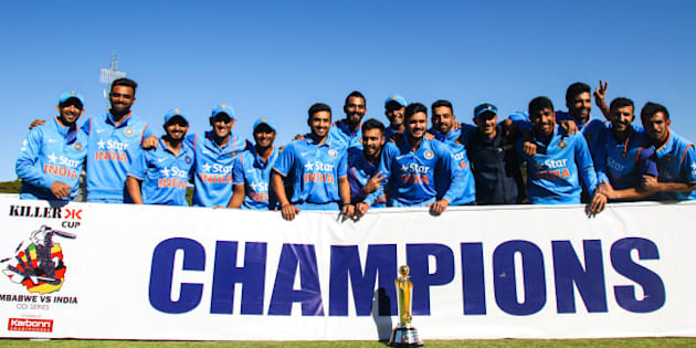 India's players pose with the ODI series trophy after winning the third and final ODI cricket match between India and Zimbabwe at the Harare Sports Club, on June 15, 2016.    India, powered by seamer Jasprit Bumrah's 4-22, crushed Zimbabwe by 10 wickets for a one-day international series whitewash at Harare Sports Club. / AFP / Jekesai Njikizana        (Photo credit should read JEKESAI NJIKIZANA/AFP/Getty Images)