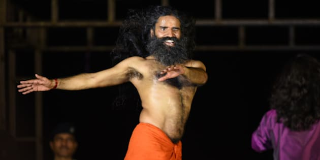 NEW DELHI, INDIA - JUNE 19: Yoga guru Baba Ramdev performs yoga during the rehearsals for the upcoming International Yoga Day at Rajpath, on June 19, 2016 in New Delhi, India. International Yoga Day is celebrated annually on June 21 and was declared to be internationally recognized by the United Nations General Assembly (UNGA) on December 11, 2014. (Photo by Virendra Singh Gosain /Hindustan Times via Getty Images)