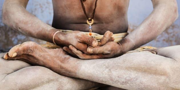 Close up of Sadhu in lotus position