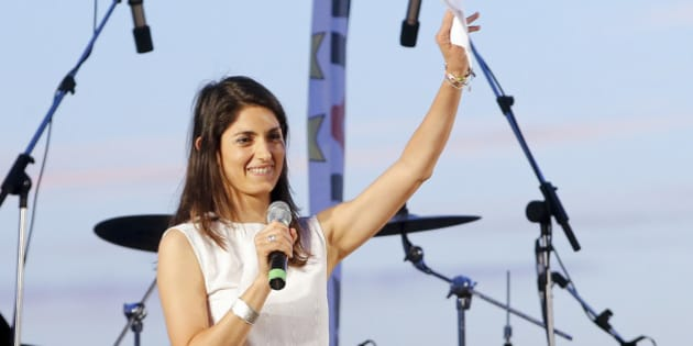 Candidate as Rome's mayor Virginia Raggi, of the 5-Star Movement, waves to supporters during a final rally in Ostia, in the outskirts of Rome, Friday,  June 17, 2016.  Raggi  took 35.3 percent of the last Sunday vote in the Italian capital, trailed by Premier Matteo Renzi's Democratic Party candidate Roberto Giachetti, with just under 25 percent. Since no candidate took more than 50 percent in balloting, the top two face a runoff on Sunday June 19. (AP Photo/Fabio Frustaci)