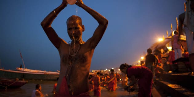 Hindu devotees bathe early morning at the River Ganges in Varanasi, India, Wednesday, July 11, 2012. Varanasi, also known as Kashi and Benaras, is Hinduism's holiest city. (AP Photo/Rajesh Kumar Singh)