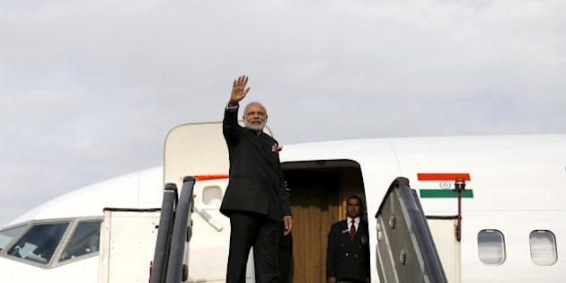 India's Prime Minister Narendra Modi waves as he boards a plane after his trip to Kabul, Afghanistan December 25, 2015. REUTERS/Mohammad Ismail