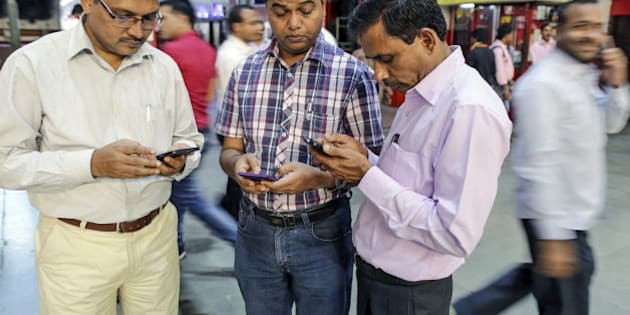 Passengers use smartphones at Mumbai Central railway station in Mumbai, India, on Friday, Jan. 22, 2016. Google Inc. in partnership with RailTel Corp. and Indian Railways today launched high speed WiFi at the station. They plan to roll out the service to more than 400 railway stations, covering 10 million passengers each day, according to chief executive officer Sundar Pichai. Photographer: Dhiraj Singh/Bloomberg via Getty Images