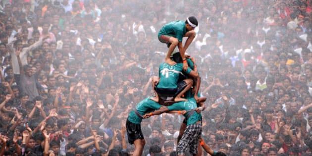 Hindu devotees form a human pyramid during the 'Dahi-handi' (curd pot) festival to celebrate Janmashtami - the birthday of Hindu God Lord Krishna in Amravati , Maharashtra ,India 10- August-2012 .