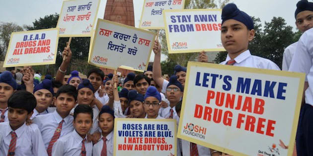 Indian students hold placards as they participate in an anti-drugs awareness march organized by the Joshi Foundation in Amritsar on April 7, 2015. AFP PHOTO/NARINDER NANU        (Photo credit should read NARINDER NANU/AFP/Getty Images)