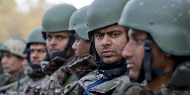 Indian army soldiers stand at the Indian air force base in Pathankot, India, Tuesday, Jan.5, 2016. Indian forces have killed the last of the six militants who attacked the air force base near the Pakistan border over the weekend, the defense minister said Tuesday, though soldiers were still searching the base as a precaution. (AP Photo/Channi Anand)