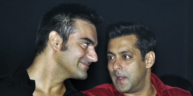Indian Bollywood actor Salman Khan (R) speaks with his brother Arbaaz at the unveiling of 'Friday Moviez', a part of Twilight Entertainment in Mumbai late September 3, 2010. AFP PHOTO/STR (Photo credit should read STRDEL/AFP/Getty Images)