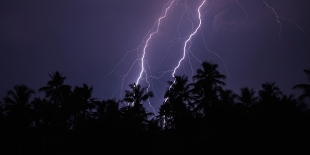 Twin lightning over the trees captured from Cochin, Kerala, India.