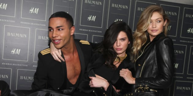Olivier Rousteing, from left, Kendall Jenner and Gigi Hadid attend the Balmain x H&M Collection launch event at 23 Wall Street on Tuesday, Oct. 20, 2015, in New York