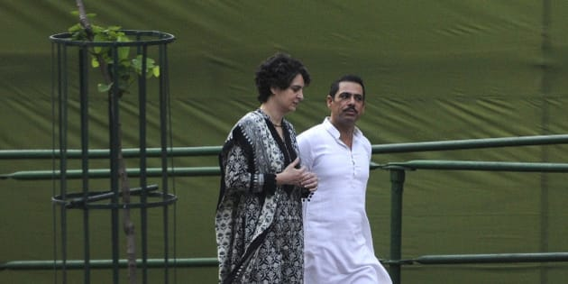 NEW DELHI, INDIA - AUGUST 20: Former Prime Minister Rajiv Gandhi's daughter Priyanka Gandhi with her husband Robert Vadra takes part in a remembrance ceremony to mark Rajiv Gandhi's 71st birth anniversary at Veer Bhumi, on August 20, 2015 in New Delhi, India. Rajiv Gandhi was assassinated during electoral campaigning, allegedly by Liberation Tigers of Tamil Eelam (LTTE) rebel separatists, in the town of Sriperumpudur, in the southern state of Tamil Nadu on May 21, 1991. (Photo by Sonu Mehta/Hindustan Times via Getty Images)