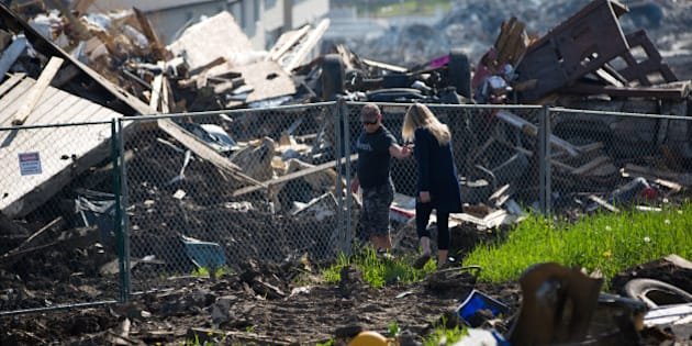 Residents look over the damage in the Timberlea neighbourhood as thousands of evacuees who fled a massive wildfire begin to trickle back to their homes in Fort McMurray, Alberta, Canada June 2, 2016. REUTERS/Topher Seguin