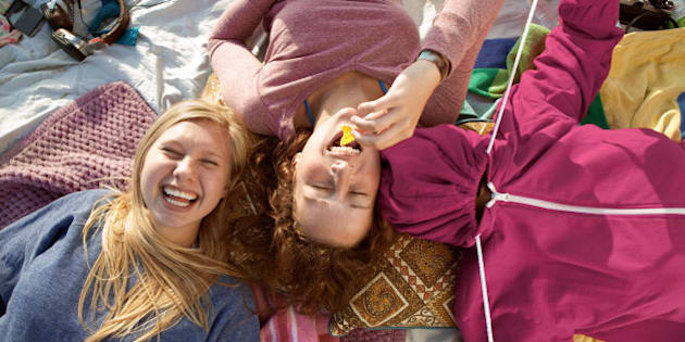 Teenage girls having fun at the beach
