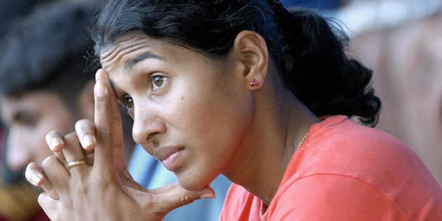 BANGALORE, INDIA:  Indian long jumper Anju Bobby George takes a rest during a training session at the Sports Authority of India (SAI) campus in Bangalore, 27 April 2004.  A determined athlete, George is striving to give her country of one billion its first Olympic medal in athletics when she competes in the long jump event in Athens this year.  AFP PHOTO/Indranil MUKHERJEE  (Photo credit should read INDRANIL MUKHERJEE/AFP/Getty Images)