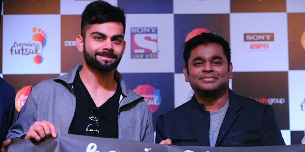 Indian cricketer VIrat Kohli(L) poses alongside Bollywood music director A.R.Rahman gestures during launch of 'Premier futsal' in Chennai on June 6, 2016. / AFP / ARUN SANKAR        (Photo credit should read ARUN SANKAR/AFP/Getty Images)
