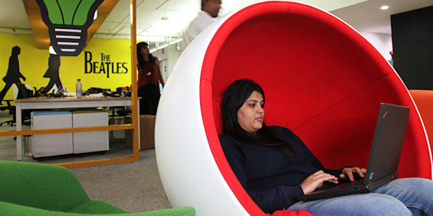 An employees sits in a chair working on a laptop computer in the office of Myntra.com, a unit of Flipkart Internet Services Pvt., in Bangaluru, India, on Friday, Dec. 04, 2015. Discounts and cashback offers helped India's top e-commerce companies from Flipkart to Snapdeal sell a record $11 billion of goods this year online. Photographer: Namas Bhojani/Bloomberg via Getty Images