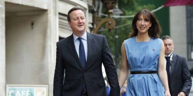 Britain's Prime Minister David Cameron and his wife Samantha arrive to vote in the EU referendum in London, Thursday June 23, 2016. Polls opened in Britain Thursday for a referendum on whether the country should quit the European Union bloc of which it has been a member for 43 years. (AP Photo/Alastair Grant)