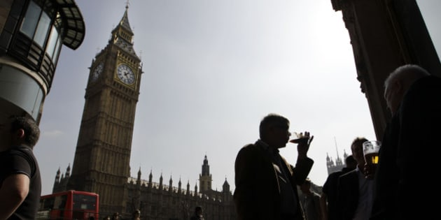 WITH STORY BRITAIN LAST ORDERS - People enjoy their beers outside a pub across from the Houses of Parliament in London, Friday, March 30, 2012, with Big Ben's clock tower at left. There are nearly 20 bars and restaurants inside Parliament, so as lawmakers try to roll out plans to restrict the consumption of alcohol in Britain, they may have to consider the availability of booze on their own doorstep, possibly signaling a call of last orders for some libations inside the Houses of parliament.  (AP Photo/Sang Tan)
