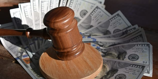 Wooden gavel and  US dollars