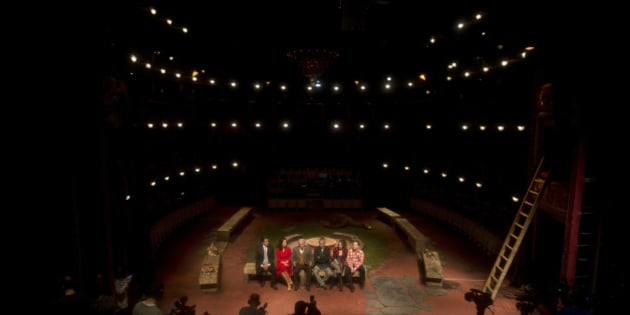 """Peruvian writer and Nobel laureate Mario Vargas Llosa, third from left on bench, speaks during a news conference alongside the cast to present the upcoming play """"Los cuentos de la peste"""" inside the Teatro Espanol in Madrid, Spain, Thursday Jan. 22, 2015. Vargas Llosa will perform in the play that runs from Jan. 28 to March 1. (AP Photo/Paul White)"""