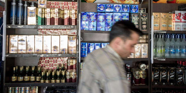 Bottles of whiskey and vodka are displayed on the shelves of a liquor store in Chandigarh, Punjab, India, on Friday, Sept. 28, 2012. Diageo Plc confirmed that it's in talks to buy a stake in billionaire Vijay Mallya's United Spirits Ltd., a deal that would help the world's biggest distiller build its presence in the Indian whiskey market. Photographer: Sanjit Das/Bloomberg via Getty Images