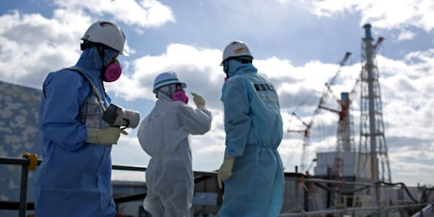 OKUMA, JAPAN - FEBRUARY 25:  A TEPCO employee uses a radiation monitor as they show a member of the media a destroyed reactor at Fukushima Daiichi nuclear power plant on February 25, 2016 in Okuma, Japan. Five years on,  the decontamination and decommissioning process at the Tokyo Electric Power Co.'s embattled Fukushima Daiichi nuclear power plant continues on February 25, 2016 in Okuma, Japan.  March 11, 2016 marks the fifth anniversary of the magnitude 9.0 earthquake and tsunami which claimed the lives of 15,894, and the subsequent damage to the reactors at TEPCO's Fukushima Daiichi Nuclear Power Plant causing the nuclear disaster which still forces 99,750 people to live as evacuees away from contaminated areas.  (Photo by Christopher Furlong/Getty Images)