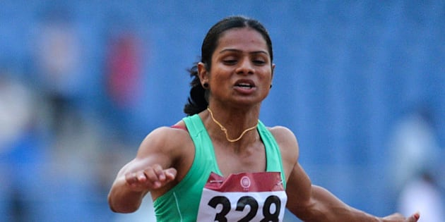 Dutee Chand of Odisha takes part in the 100 metre race during 20th Federation Cup National Senior Athletics Championship in New Delhi on April 28, 2016. / AFP / CHANDAN KHANNA        (Photo credit should read CHANDAN KHANNA/AFP/Getty Images)