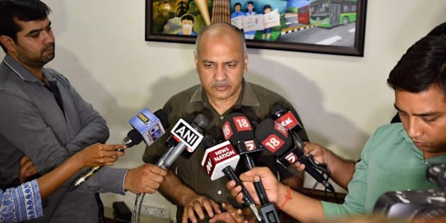 NEW DELHI, INDIA - JUNE 25: Delhi Deputy CM Manish Sisodia addressing the media after the Police arrested AAP legislator Dinesh Mohaniya for allegedly misbehaving with a woman and slapping a 60-year-old man, at his residence on June 25, 2016 in New Delhi, India. Mohaniya was arrested on charges of 'sexual harassment' on the complaint of a woman who visited his office-cum residence two days ago as part of a group to complain about irregular water supply, and slapping a 60-year-old man at Tughlakabad. Mohaniya, an MLA from Sangam Vihar constituency in south Delhi, was picked up by a team of Delhi Police while he was addressing a press conference at his residence in Sangam Vihar. (Photo by Ravi Choudhary/Hindustan Times via Getty Images)