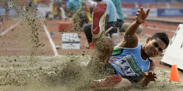 India's Ankit Sharma competes in a Men's Long Jump qualification during the Commonwealth Games at the Jawaharlal Nehru Stadium in New Delhi, India, Friday, Oct. 8, 2010. (AP Photo/Lee Jin-man)