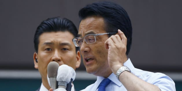 Japan's main opposition Democratic Party leader Katsuya Okada delivers a speech during an election campaign at the Shinjuku shopping street in Tokyo, Wednesday, June 22, 2016. Japan's parliamentary election campaign kicked off Wednesday in the first nationwide balloting after the voting age was lowered to 18 from 20. (AP Photo/Shizuo Kambayashi)