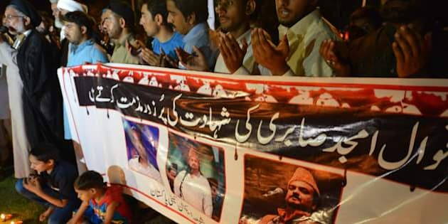 Pakistani Shiite Muslim protesters pray as they pay tribute to Sufi musician Amjad Sabri who was killed in an attack by unknown gunmen, in Islamabad on June 22, 2016. One of Pakistan's best known Sufi musicians was shot dead by unknown assailants riding a motorcycle in Karachi on June 22, triggering an outpouring of grief over what police described as an 'act of terror'. Amjad Sabri, aged around 45, was travelling by car from his home in the city's eastern Korangi area to a television studio, when a motorcycle pulled up alongside the vehicle and the attackers opened fire, Farooq Sanjarani, a police officer said.  / AFP / AAMIR QURESHI        (Photo credit should read AAMIR QURESHI/AFP/Getty Images)