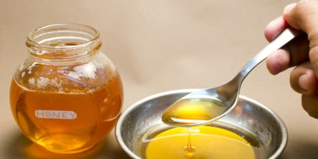 Honey being taken away with spoon