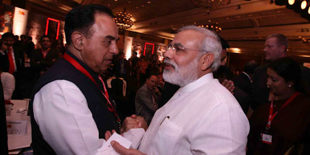 NEW DELHI, INDIA - MARCH 18: Gujarat Chief Minister Narendra Modi and Janta Dal Chief Subramanian Swamy at the 10th India Today Conclave being held in the capital on March 18-19, 2011 at Taj Palace Hotel. (Photo by Shekhar Yadav/India Today Group/Getty Images)
