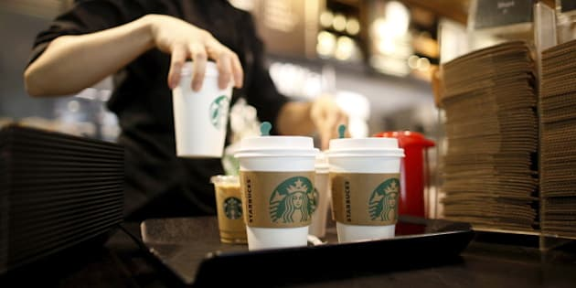 A staff serves beverages at a Starbucks coffee shop in Seoul, South Korea, March 7, 2016. Picture taken March 7, 2016. REUTERS/Kim Hong-Ji