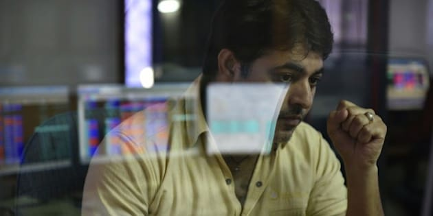MUMBAI, INDIA - JUNE 25: A broker looks at his computer screen displaying the Sensex after Britain's exit from the European Union (EU), on June 25, 2016 in Mumbai, India. Britain voted to break away from the European Union on Friday, shattering the unity of a 60-year-old continental bloc, prompting the exit of Prime Minister David Cameron and rattling the world of finance and business. In India, shares fell more than 4% on the news but recovered by half after authorities moved to calm investor worries. The benchmark BSE ended 2.2% down, its biggest single-day percentage fall since February. (Photo by Arijit Sen/Hindustan Times via Getty Images)