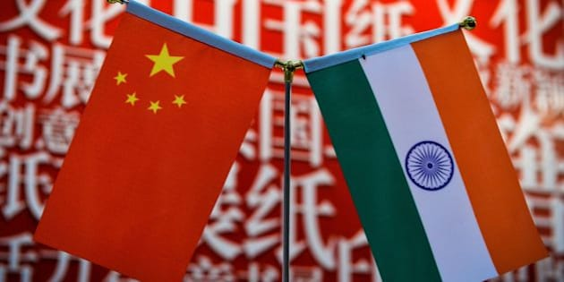 The national flags of India (R) and China are seen at the Delhi World Book fair at Pragati Maidan in New Delhi on January 9, 2016.   AFP PHOTO / CHANDAN KHANNA / AFP / Chandan Khanna        (Photo credit should read CHANDAN KHANNA/AFP/Getty Images)