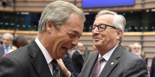 European Commission President Jean-Claude Juncker, right, greets UKIP leader Nigel Farage during a special session of European Parliament in Brussels on Tuesday, June 28, 2016. EU heads of state and government meet Tuesday and Wednesday in Brussels for the first time since Britain voted to leave the European Union, throwing British and European politics into disarray. (AP Photo/Geert Vanden Wijngaert)