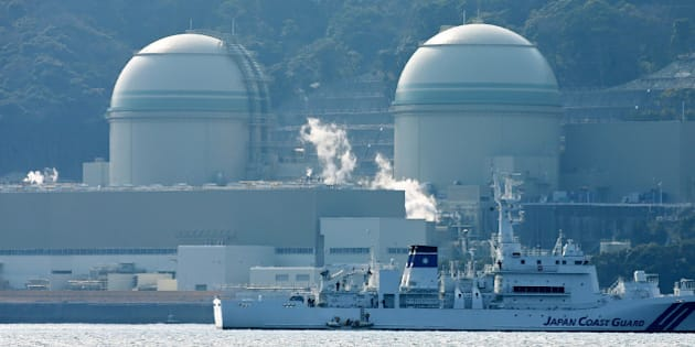 This picture taken on February 26, 2016 shows Kansai Electric Power's number 3 (L) and number 4 (R) reactors at the Takahama nuclear plant in western Japan's Fukui prefecture. A Japanese utility on February 29 said that a surprise glitch has switched off a nuclear reactor just days after it was turned on again after a nationwide shutdown following the 2011 Fukushima crisis.   JAPAN OUT       AFP PHOTO / JIJI PRESS / AFP / JIJI PRESS / JIJI PRESS        (Photo credit should read JIJI PRESS/AFP/Getty Images)