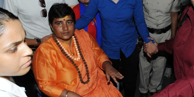 BHOPAL, INDIA - MAY 18: Hindu activist Sadhvi Pragya Singh Thakur leaving for Simhastha in Ujjain under heavy police protection on May 18, 2016 in Bhopal, India. Pragya Singh Thakur, who got a clean chit from the NIA in the 2008 Malegaon blasts case, went on an indefinite hunger strike on Monday to press for her demand that she be allowed to take a dip in Kshipra in Ujjain during the ongoing Simhastha. (Photo by Praveen Bajpai/Hindustan Times via Getty Images)