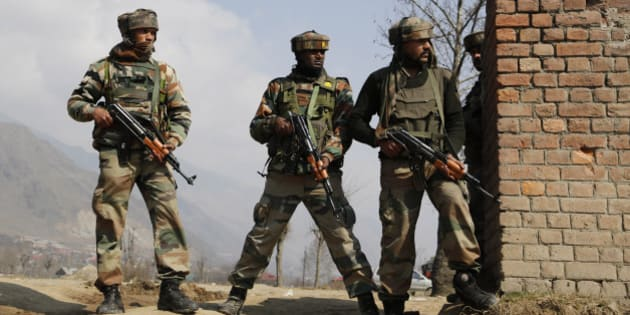 Indian Army soldiers take position during a gunbattle between Indian security forces and Kashmiri rebels in Pampore, near Srinagar, Indian controlled Kashmir, Indian-controlled Kashmir, Monday, Feb. 22, 2016. Anti-India sentiment runs deep in India's portion of Kashmir, where rebel groups have been fighting since 1989 for either independence or a merger with neighboring Pakistan. More than 68,000 people have been killed in the armed uprising and ensuing Indian military crackdown. (AP Photo/Mukhtar Khan)