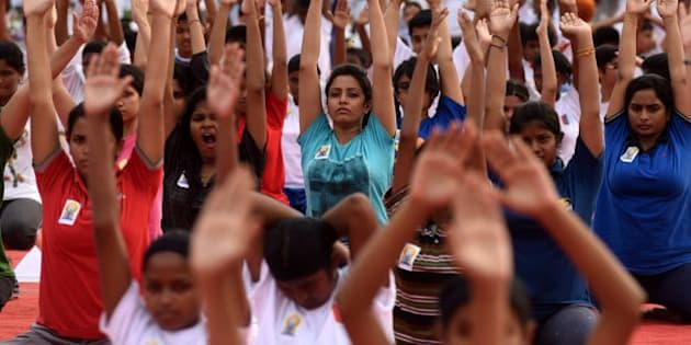 Indian students participate in a yoga demonstration on International Yoga Day in Chennai on June 21, 2016  Yoga, which means union in Sanskrit, is a family of ancient spiritual practices and also a school of spiritual thought from the South East Asian continent, where it remains a vibrant living tradition and is seen as a means of enlightenment. / AFP / ARUN SANKAR        (Photo credit should read ARUN SANKAR/AFP/Getty Images)