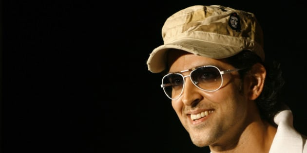 Bollywood actor Hrithik Roshan smiles during a promotional event of a beverage manufacturing company in New Delhi May 23, 2008. REUTERS/Vijay Mathur (INDIA)