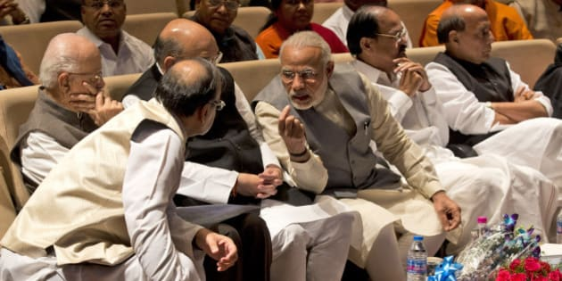 Indian Prime Minister Narendra Modi, third right, talks with Indian Finance Minister Arun Jaitley during a meeting of ruling National Democratic Alliance lawmakers in New Delhi, India, Tuesday, March 1, 2016. The meeting was to discuss attacks from the opposition on various issues and to thank Modi and Jaitley for presenting the federal budget. (AP Photo/Manish Swarup)