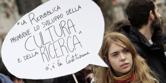 "Students protest against the government-proposed education reforms which are being discussed at the Italian senate, in Rome, Wednesday, Dec. 22, 2010. Thousands of students across Italy are demonstrating Wednesday as the senate is expected to vote the cuts and reforms proposed by the Education minister Mariastella Gelmini. The banner reads: ""La Repubblica promuove lo sviluppo della cultura e della ricerca. Si, e' la Costituzione"" (The Repubblic promotes the development of culture and research. Yes, it's the Constitution). (AP Photo/Riccardo De Luca)"