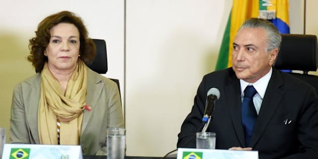 Brazil's acting President Michel Temer (R) and National Secretary of Policy for Women Fatima Pelaes are pictured during a meeting with the secretaries of security of Brazilian states, in Brasilia, on May 31, 2016.