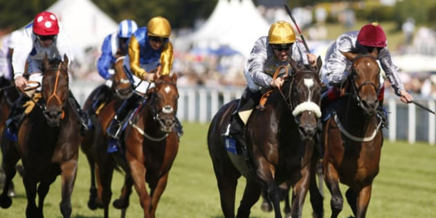 CHICHESTER, ENGLAND - JULY 31: Gregory Benoit riding Amy Eria (2R) win The L'Ormarins Queen's Plate Stakes at Goodwood racecourse on July 31, 2015 in Chichester, England. (Photo by Alan Crowhurst/Getty Images)