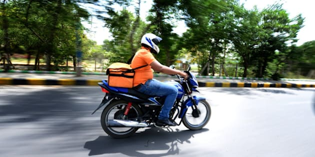 GURGAON, INDIA - MAY 7: Aakash from Online Grocery Shopping portal Grofers going to deliver the consumables to the client on May 7, 2015 in Gurgaon, India. (Photo by Ramesh Pathania/Mint via Getty Images)